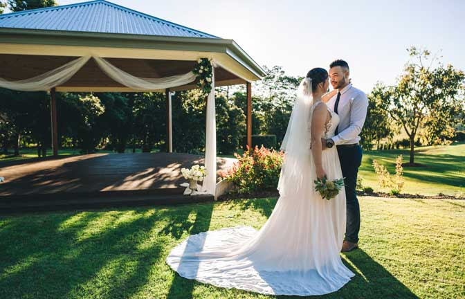 A bride and groom at Summerland House Farm